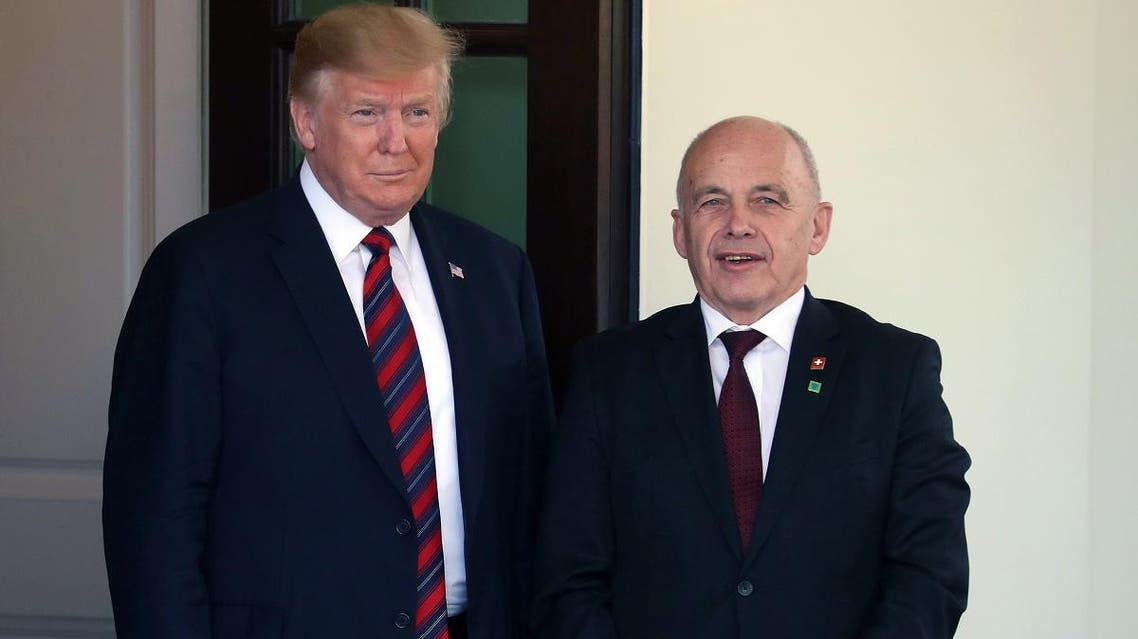 US President Donald Trump welcomes President Ueli Maurer of the Swiss Confederation, upon his arrival for a meeting in the Oval Office on May 16, 2019 in Washington, DC. (AFP)