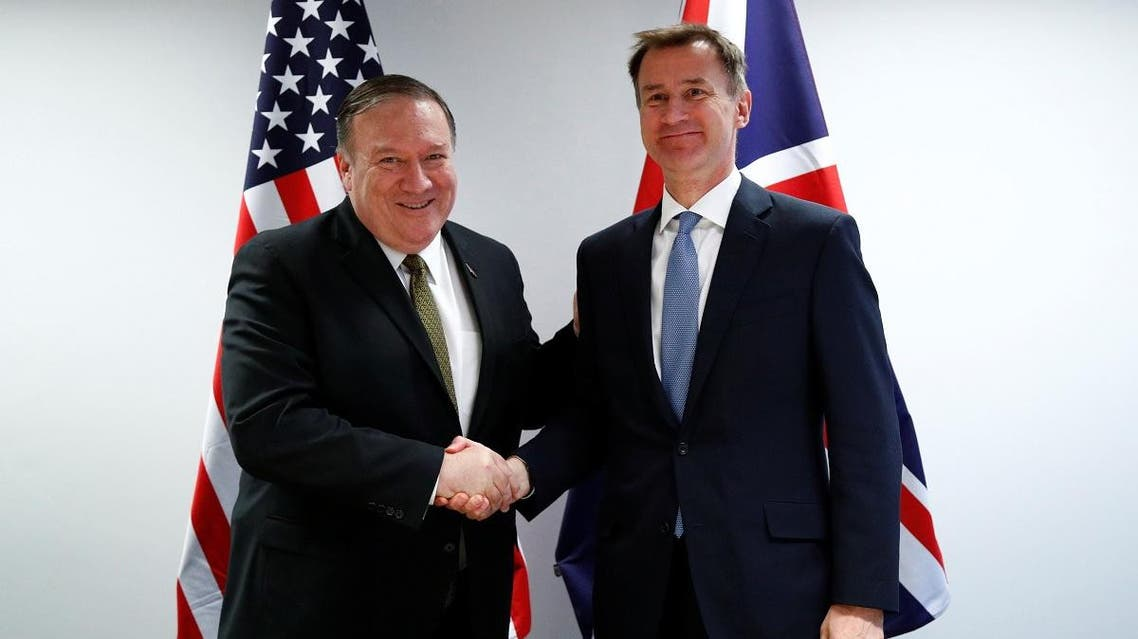 U.S. Secretary of State Mike Pompeo poses with Britain's Foreign Secretary Jeremy Hunt at the European Council in Brussels, Belgium, May 13, 2019. (Reuters)