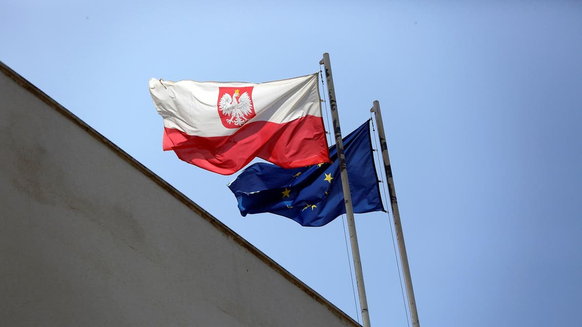 Poland's flag flutters near the European Union flag on the building of the Polish Embassy in Tel Aviv on May 15, 2019. (Reuters)