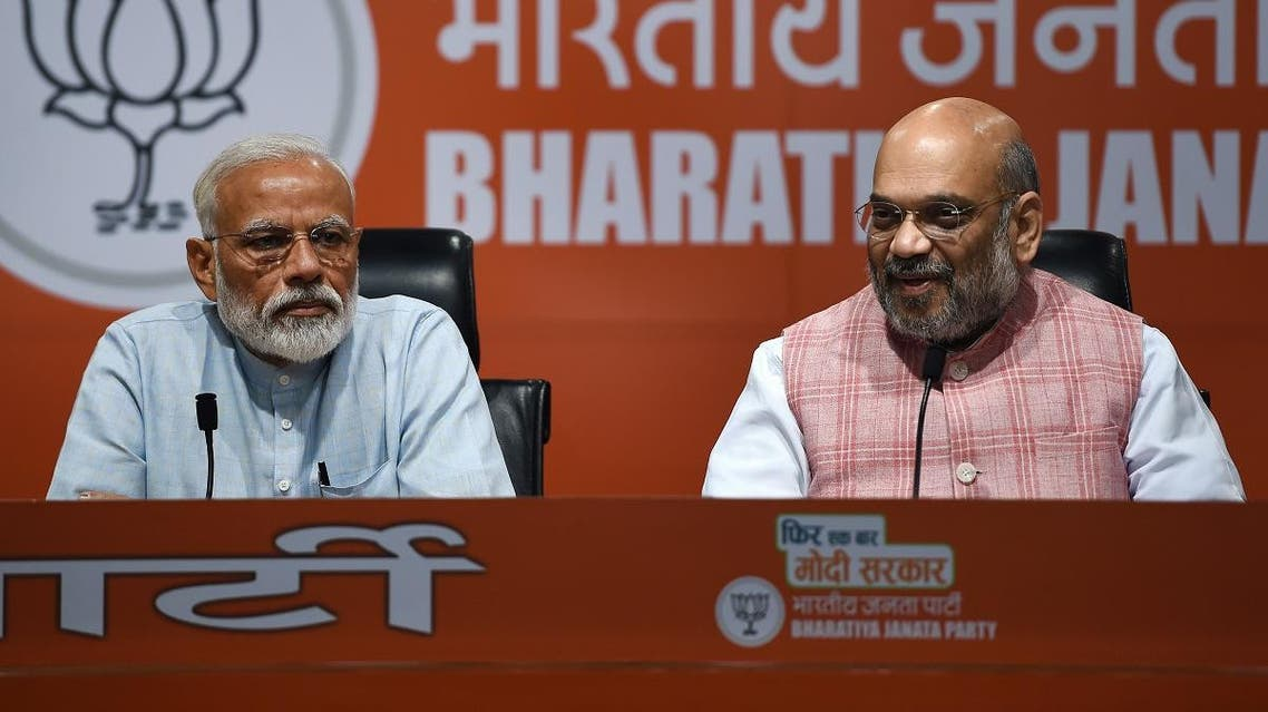 Indian Prime Minister Narendra Modi (L) and Bharatiya Janata Party president Amit Shah take part in a press conference in New Delhi on May 17, 2019. (AFP)