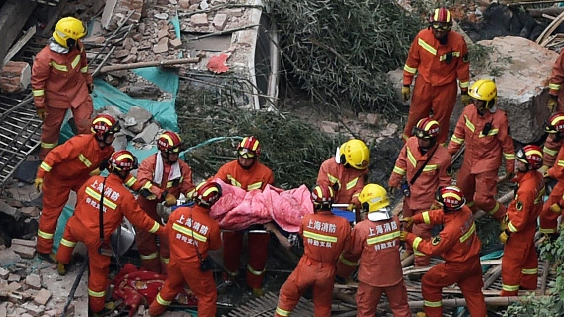 Members of a rescue team carry out a victim of a building collapse in Shanghai on May 16, 2019. (AFP
