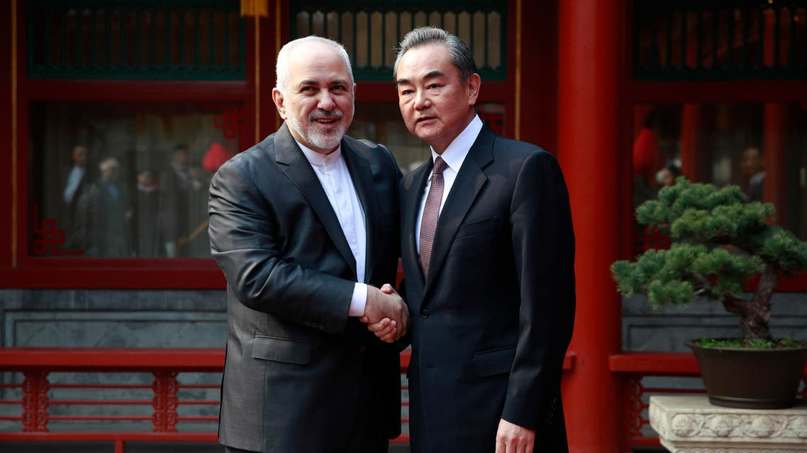 Javad Zarif (L) and his Chinese counterpart Wang Yi in Beijing on February 19, 2019. (AFP)