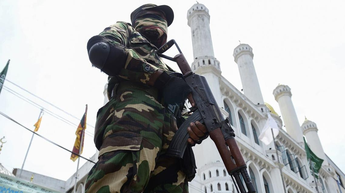 A Sri Lankan security personnel stands guard outside a mosque in Colombo on May 17, 2019. (AFP)