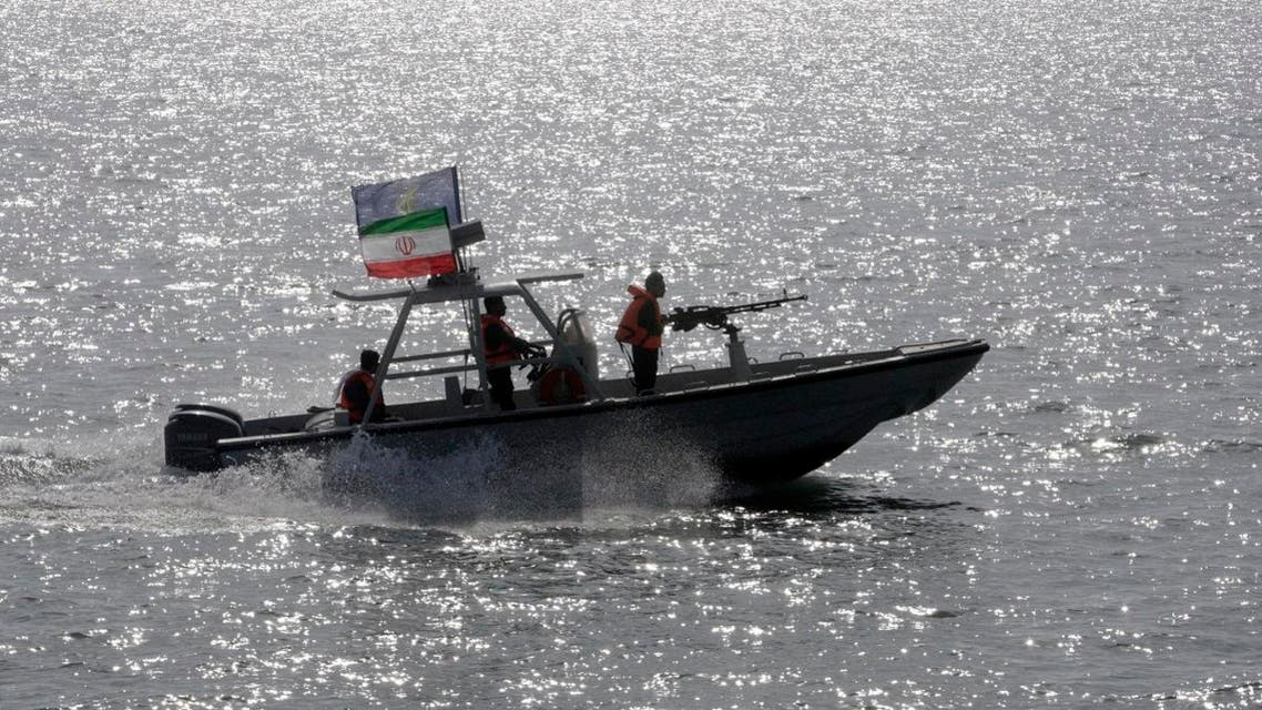 An Iranian Revolutionary Guard speedboat escorts a passenger ship. (Illustrative photo: AP)