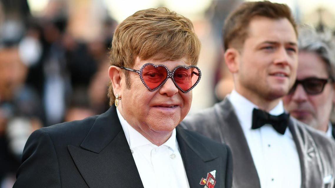 """Elton John arrives for the screening of the film """"Rocketman"""" at the 72nd edition of the Cannes Film Festival in Cannes on May 16, 2019. (AFP)"""