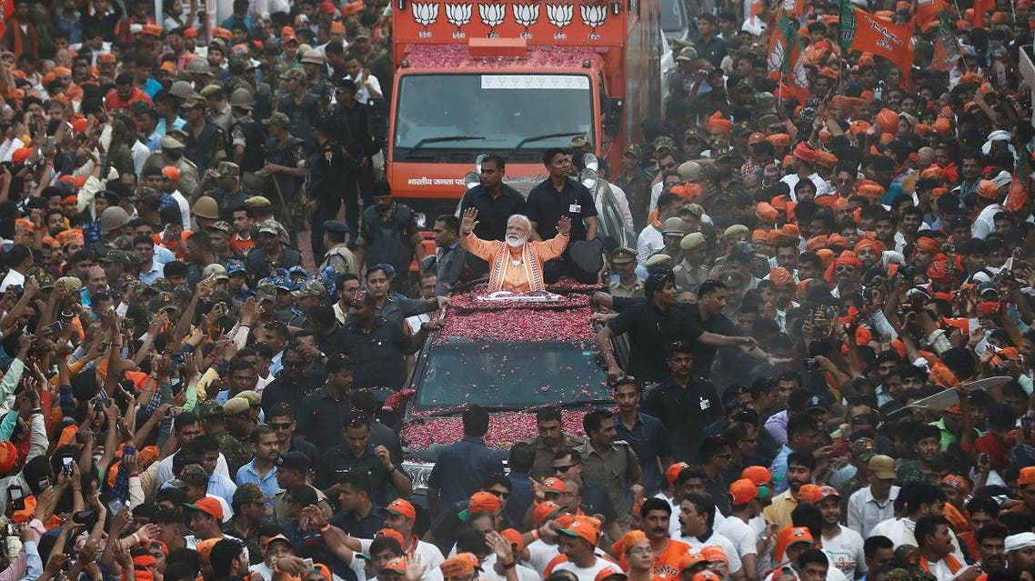 India's Prime Minister Narendra Modi waves towards his supporters during a roadshow in Varanasi, India, April 25, 2019. (Reuters)