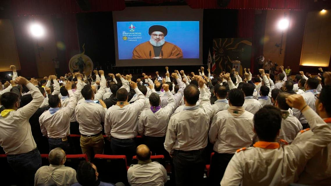 Hezbollah scouts raise their fists and cheer as they listen to a speech by Hezbollah leader Hassan Nasrallah. (File photo: AP)