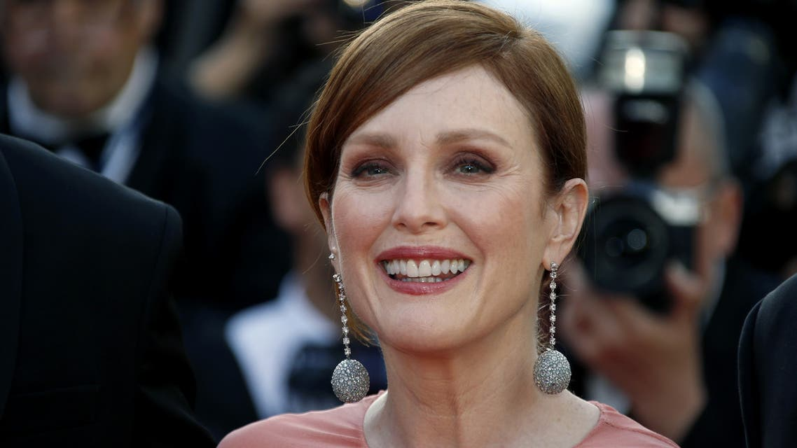 72nd Cannes Film Festival - Red Carpet Arrivals - Cannes, France, May 16, 2019. Julianne Moore poses ahead of screening of the 5B movie. REUTERS/Jean-Paul Pelissier