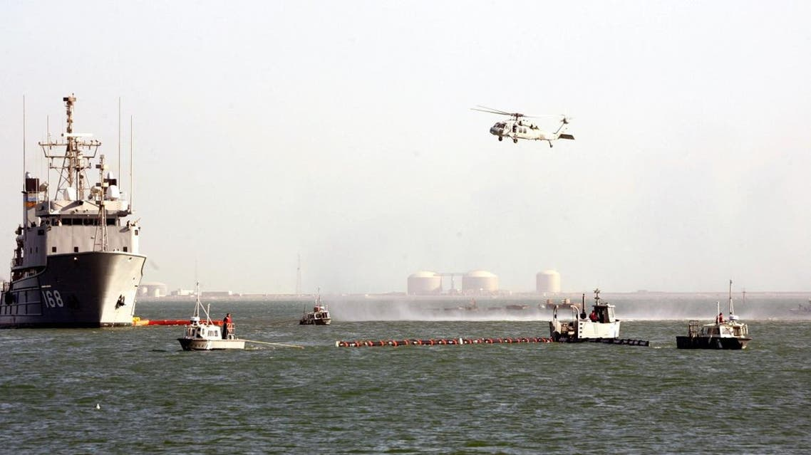 A US Navy Ocean Tug ship and helicopter of the Bahrain-based Fifth Fleet particpates in a crisis response exercise in a port in the capital Manama. (File photo: AFP)
