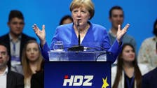 Merkel urges Europe to stand up to politicians 'for sale'