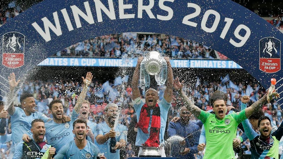 Manchester City players celebrate after winning the English FA Cup Final soccer match between Manchester City and Watford at Wembley stadium in London, on May 18, 2019.