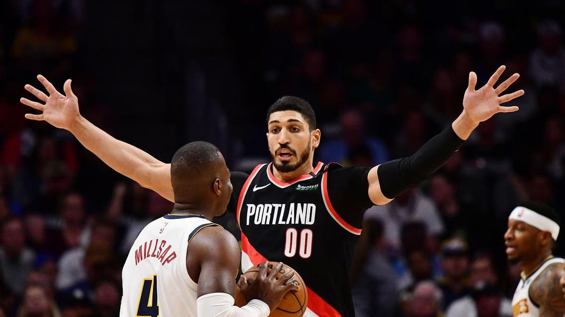 Portland Trail Blazers center Enes Kanter (00) pressures Denver Nuggets forward Paul Millsap (4) in the first quarter in game five of the second round of the 2019 NBA Playoffs at Pepsi Center. (Ron Chenoy/USA TODAY Sports)