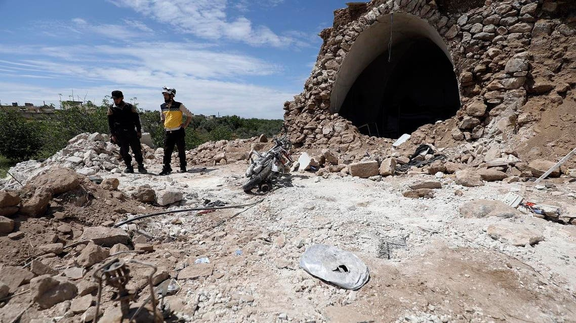 A member of the Syrian Civil Defence (White Helmets) inspects the rubble following shelling by Syrian regime forces on the village of Maarit Sin in the countryside of the rebel-held Idlib province. (AFP)