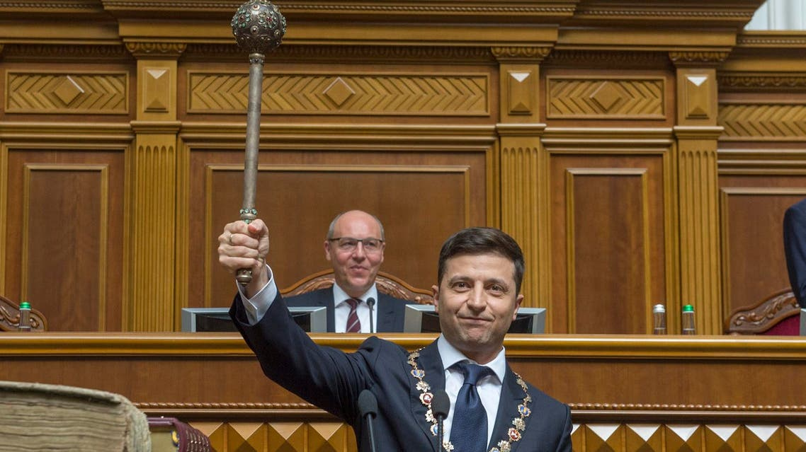 The new Ukrainian President Volodymyr Zelenskiy holds up a mace, the Ukrainian symbol of power, during his inauguration ceremony in Kiev on May 20, 2019. (AP)
