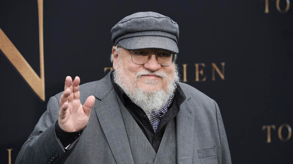 """Author George R.R. Martin waves to photographers at the premiere of the film """"Tolkien,"""" at the Regency Village Theatre. (AP)"""