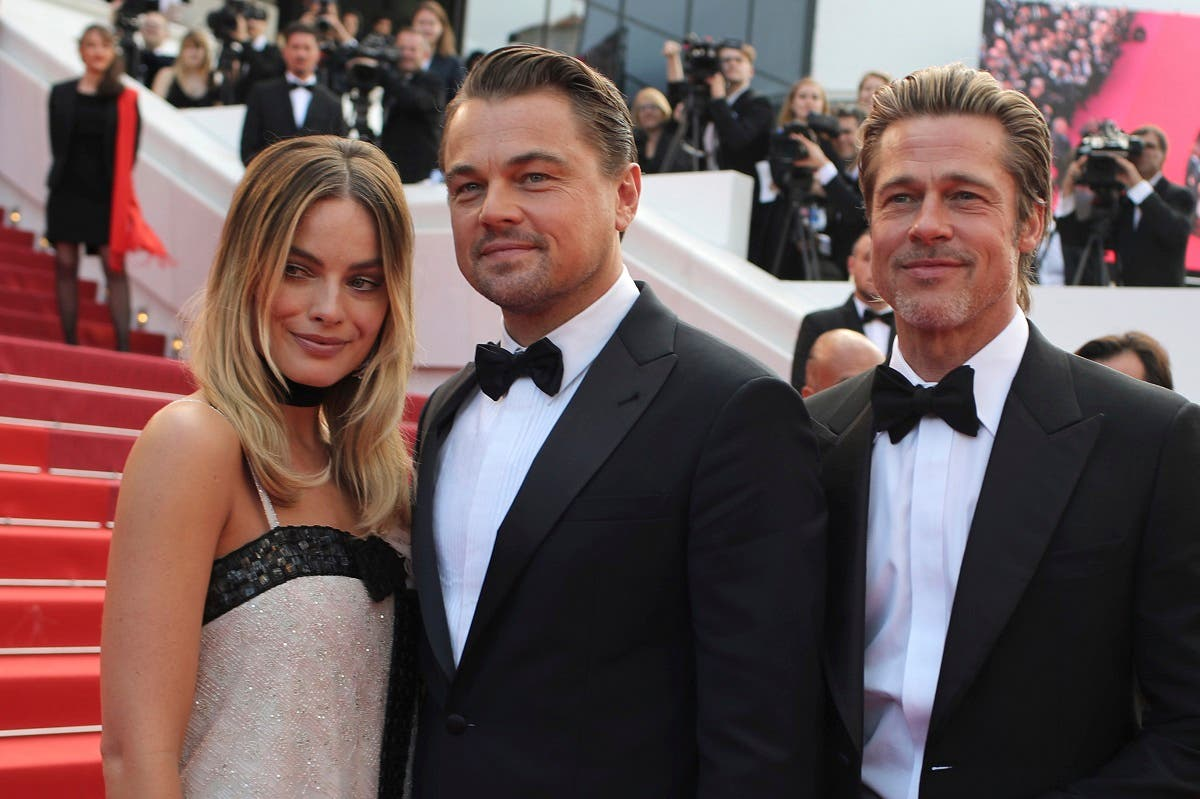 Actors Margot Robbie from left, Leonardo DiCaprio and Brad Pitt poses for photographers upon arrival at the premiere of the film 'Once Upon a Time in Hollywood' at the 72nd international film festival, Cannes, southern France, Tuesday, May 21, 2019. (AP)