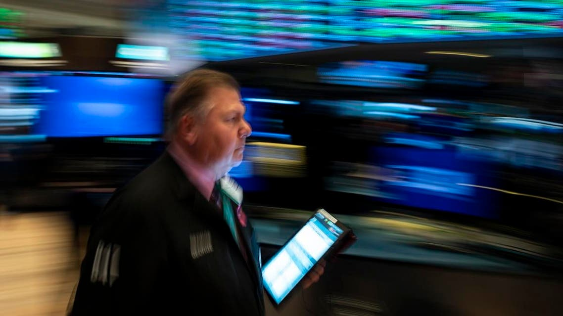 Traders work after the opening bell at the New York Stock Exchange (NYSE) on May 1, 2019. (AFP)