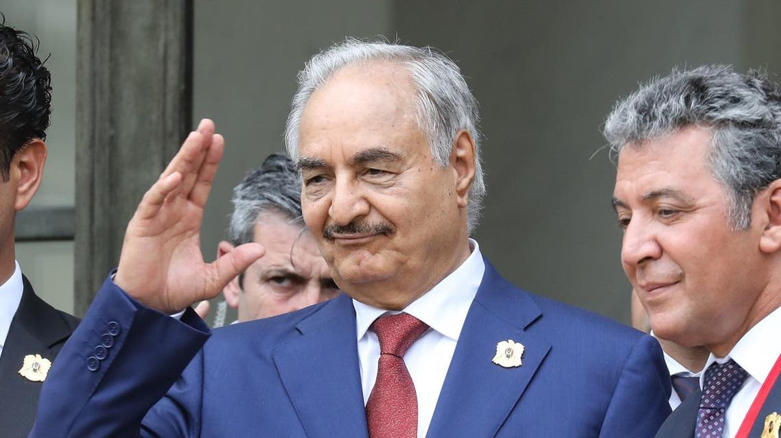 Libya Chief of Staff, Marshall Khalifa Haftar, whose rival Libyan National Army dominates the country's east, gestures as he stands on the steps of the Elysee Palace following the International conference on Libya on May 29, 2018. (AFP)