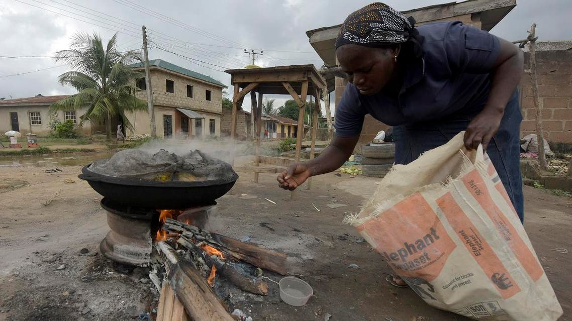 A Nigerian woman cooks food corn with firewood which is largely used for cooking in sub-Saharan Africa. (File photo: AFP)