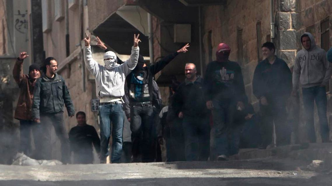 Anti-Syrian government protesters flash Victory signs as they protest in the southern city of Daraa, Syria. (File photo: AP)