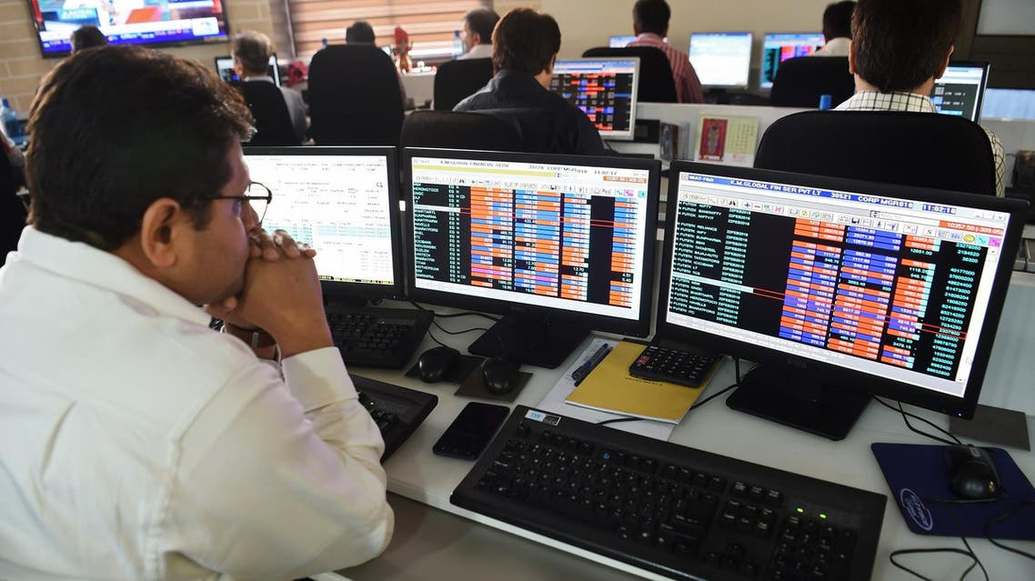 An Indian stock trader looks at share prices during intra-day trade at a brokerage house in Mumbai on February 6, 2018. (File photo: AFP)