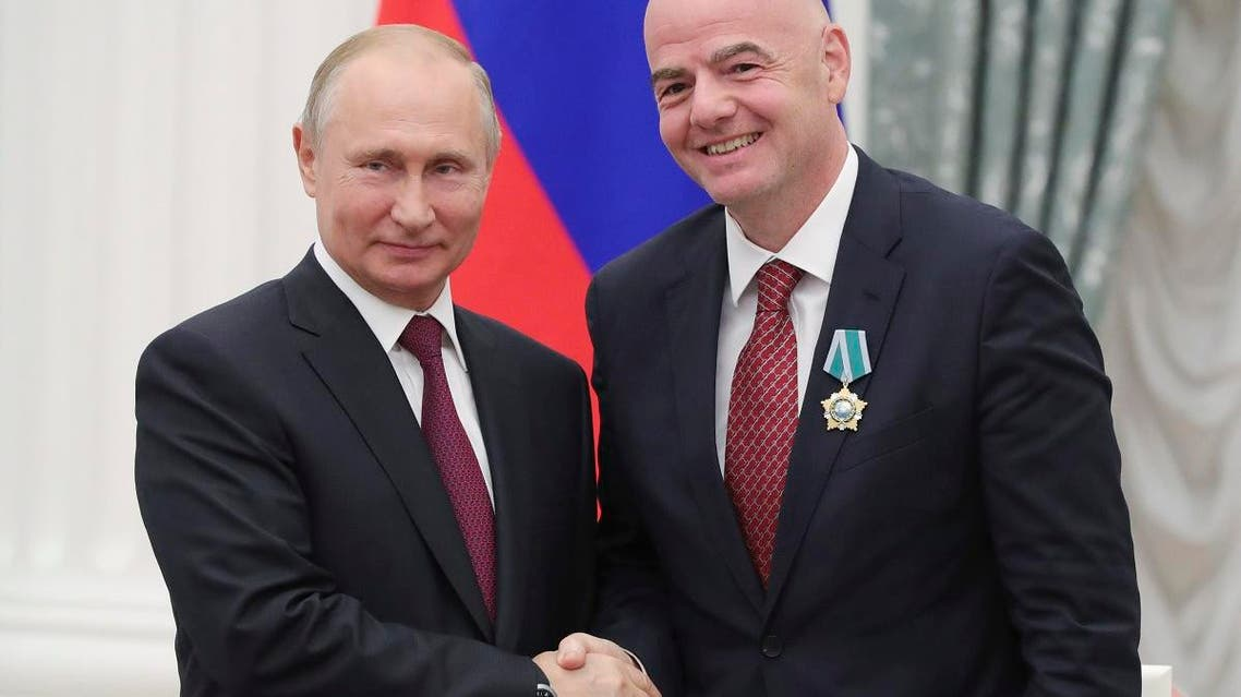 Russian President Vladimir Putin shakes hands with FIFA President Gianni Infantino during an awarding ceremony in the Kremlin in Moscow, Russia, on May 23, 2019. (AP)