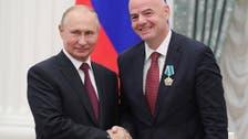 Putin awards medal to FIFA president Infantino