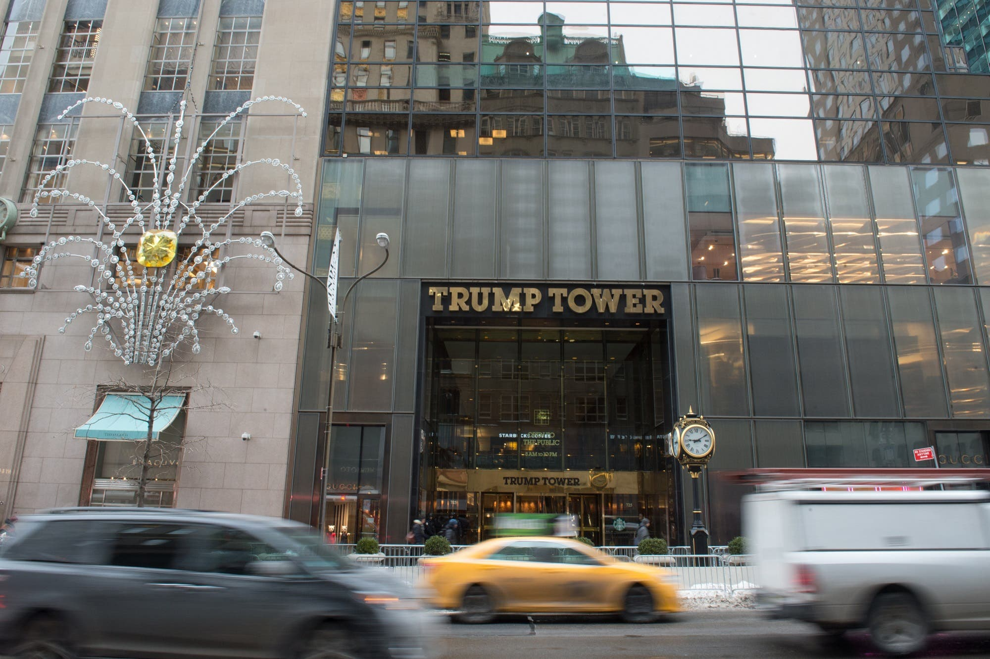 Cars drive past the front of Trump Tower on Fifth Avenue in New York on January 8, 2018. (AFP)
