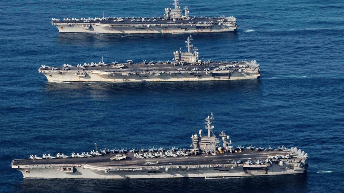 File photo of the aircraft carriers USS Ronald Reagan (CVN 76), USS Theodore Roosevelt (CVN 71) and USS Nimitz (CVN 68) conducting operations as part of a three-carrier strike force exercise in western Pacific. (Reuters)