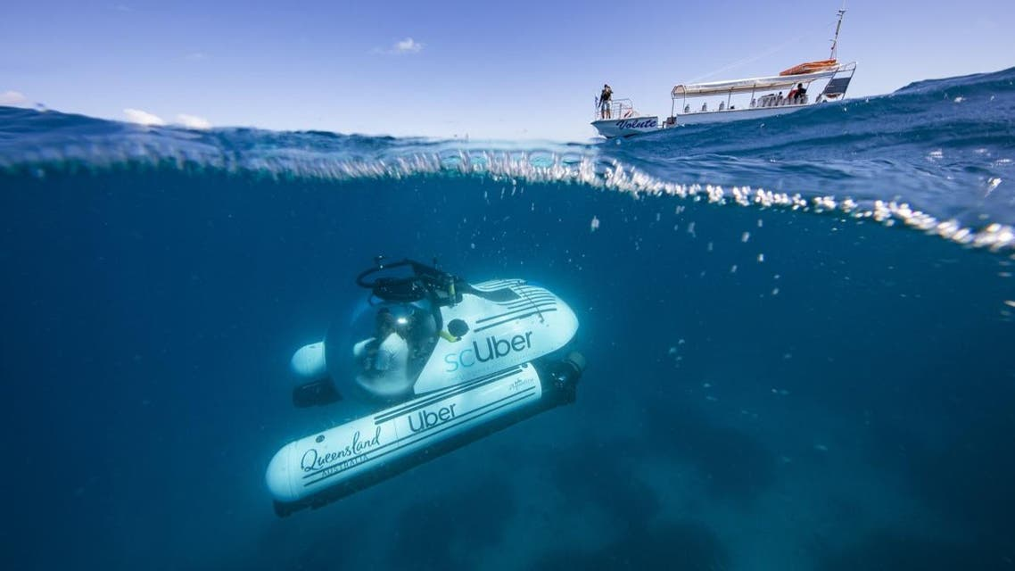 A handout photo dated May 22, 2019 by Uber shows a Uber submarine diving on the Great Barrier Reef at Heron Island in Queensland. (AFP)
