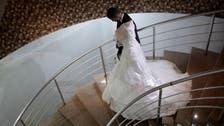 For Gaza grooms, crippling debt overshadows marital bliss