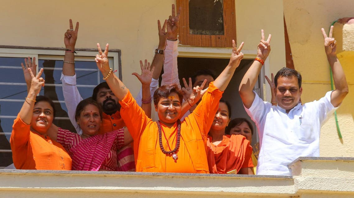 Pragya Singh Thakur gestures along with other BPJ supporters on the vote results day at her residence in Bhopal on May 23, 2019. (AFP)