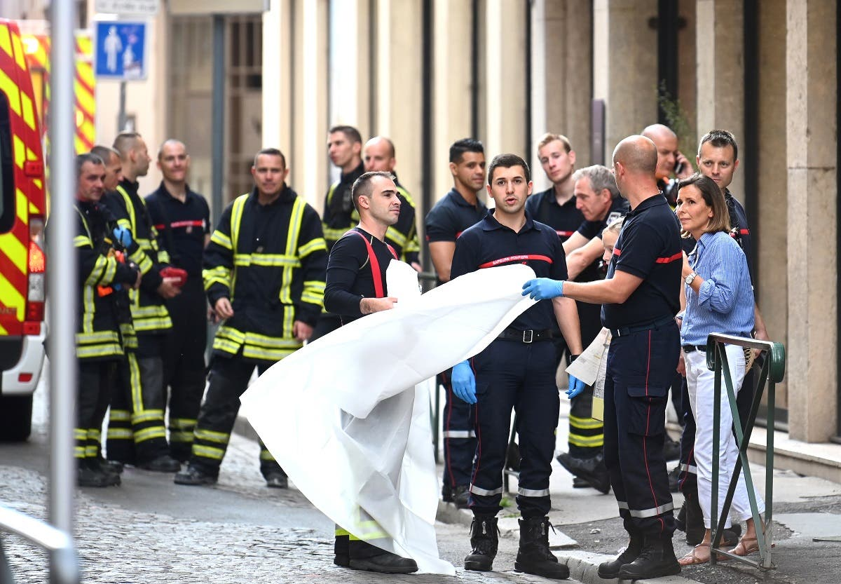 French emergency workers arrive at the scene of a suspected package bomb blast along a pedestrian street in the heart of Lyon, southeast France on May 24, 2019. (AFP)