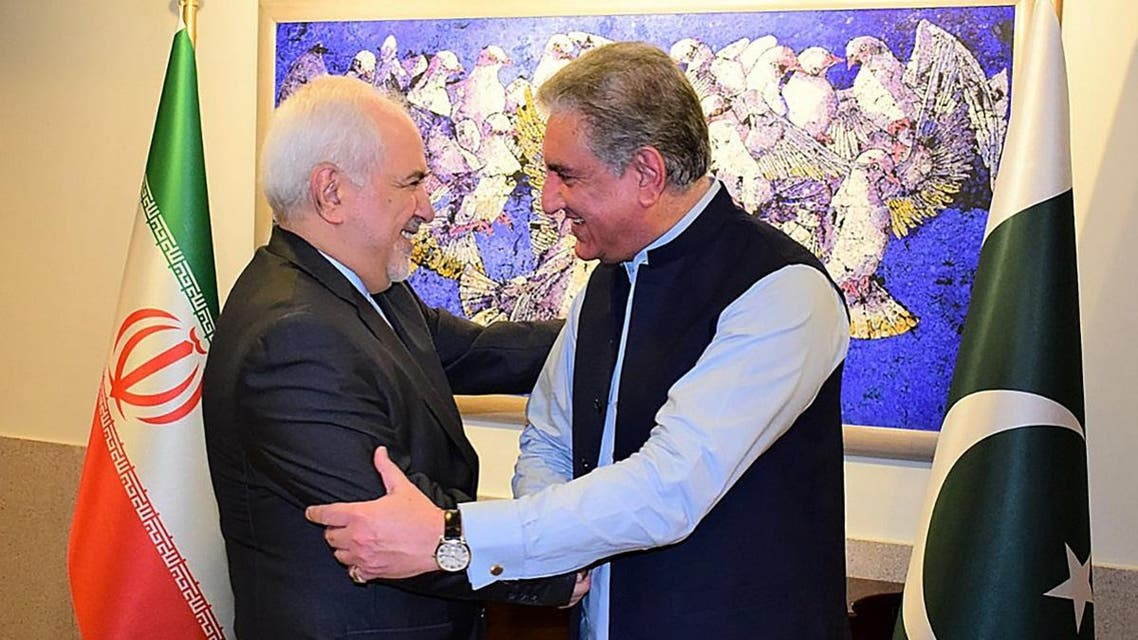 Pakistan's Foreign Minister Shah Mehmood Qureshi (R) greets his Iranian counterpart Mohammad Javad Zarif at the Foreign Ministry in Islamabad on May 24, 2019. (AFP).