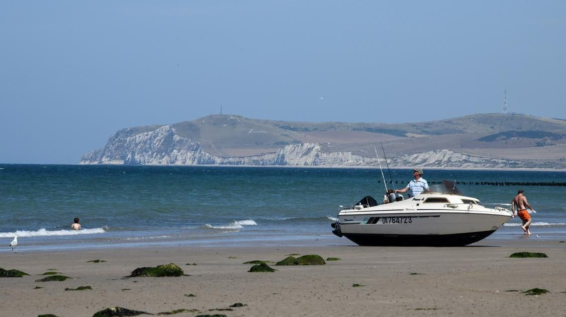 This photo taken on July 23, 2018 shows a stranded pleasure boat on the Cap Gris Nez beach, near Boulogne sur Mer, northern France. DENIS CHARLET / AFP