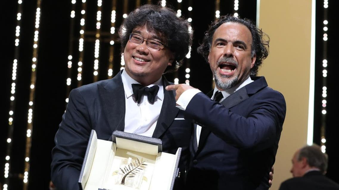 South Korean director Bong Joon-Ho (L) poses on stage with Mexican director and President of the Jury of the Cannes Film Festival Alejandro Gonzalez Inarritu after he was awarded with the Palme d'Or. (AFP)