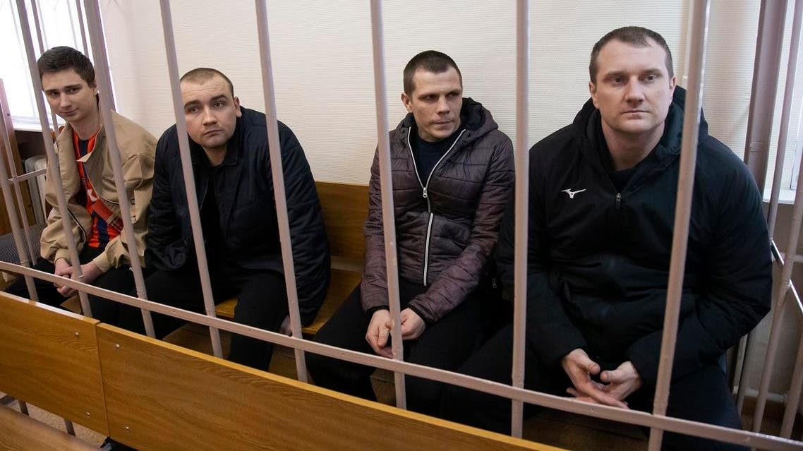 Ukrainian sailors sit in a cage in a courtroom in Moscow, Russia, on April 17, 2019.