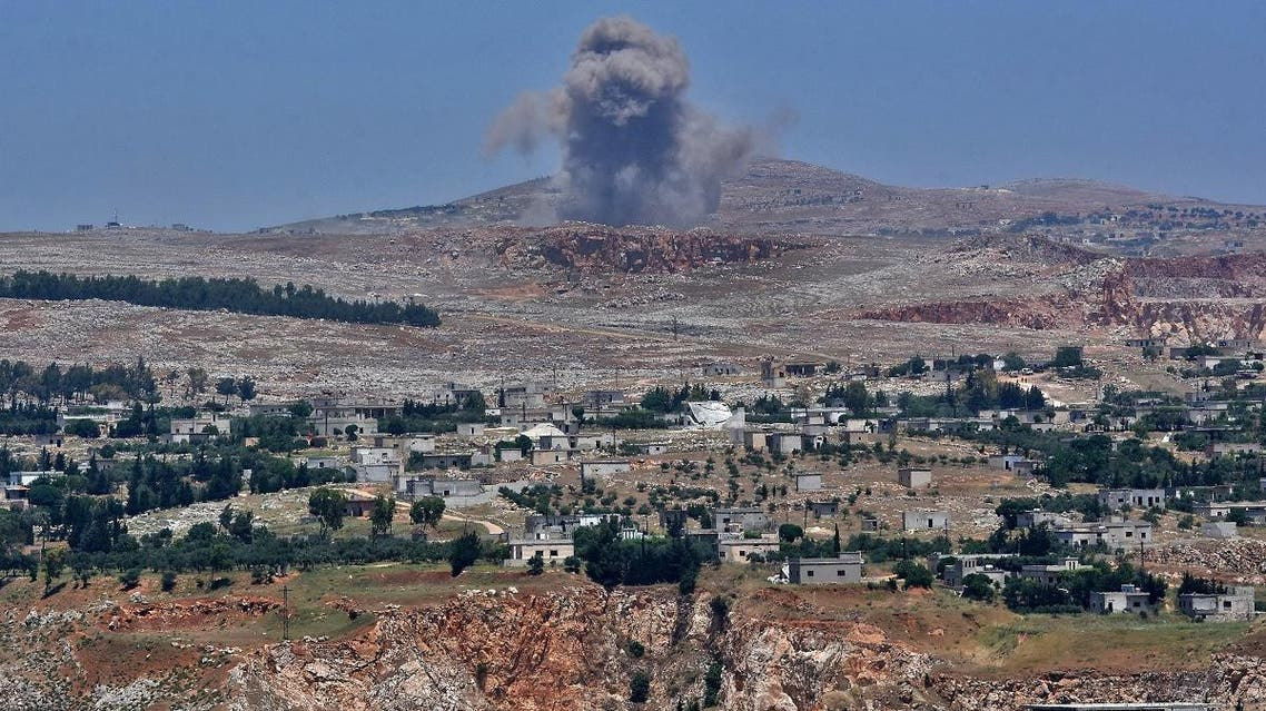 This picture taken on May 17, 2019 from the Syrian town of Qalaat al-Madiq, some 45 kilometres northwest of the central city of Hama, shows bombardment by Syrian government forces on the Shashabo Mountain. (AFP)