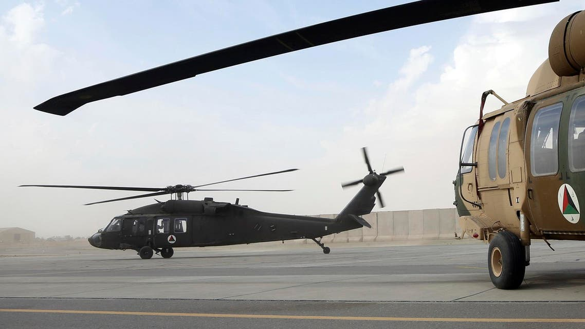 In this Monday, March 19, 2018, photo, UH-60 Black Hawk helicopter carrying US advisers and Afghan trainees take off at Kandahar Air Field, Afghanistan. AP