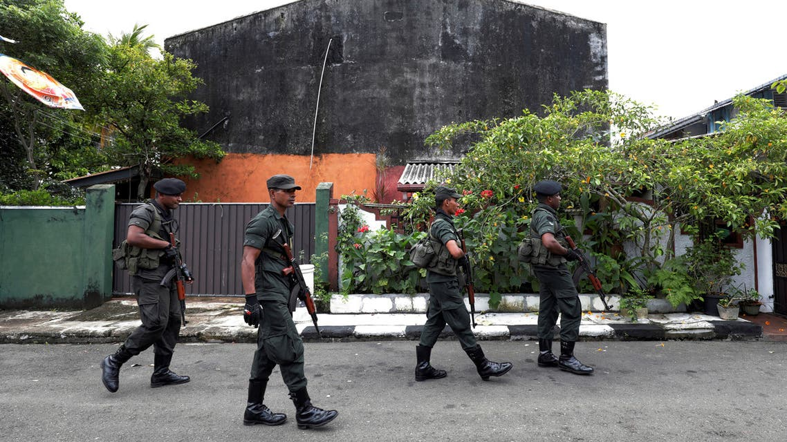 Sri Lankan army soldiers patrol on a road while other soldiers search houses during a special cordon and search operation conducted by the military in Sri Lanka's capital Colombo and suburbs, five weeks after Easter Sunday bomb attacks, in Mattegoda, Sri Lanka May 25, 2019. REUTERS/Dinuka Liyanawatte