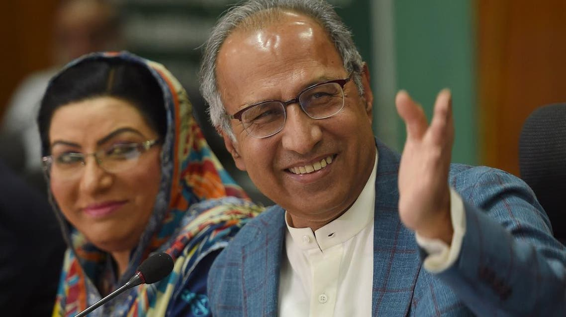 Advisor to Prime Minister Imran Khan on Finance, Revenue and Economic Affairs Abdul Hafeez Shaikh (L) gestures during a press conference next to special assistant to the Prime Minister for Information and Broadcasting Firdous Ashiq Awan, in Islamabad on May 25, 2019. (AFP)