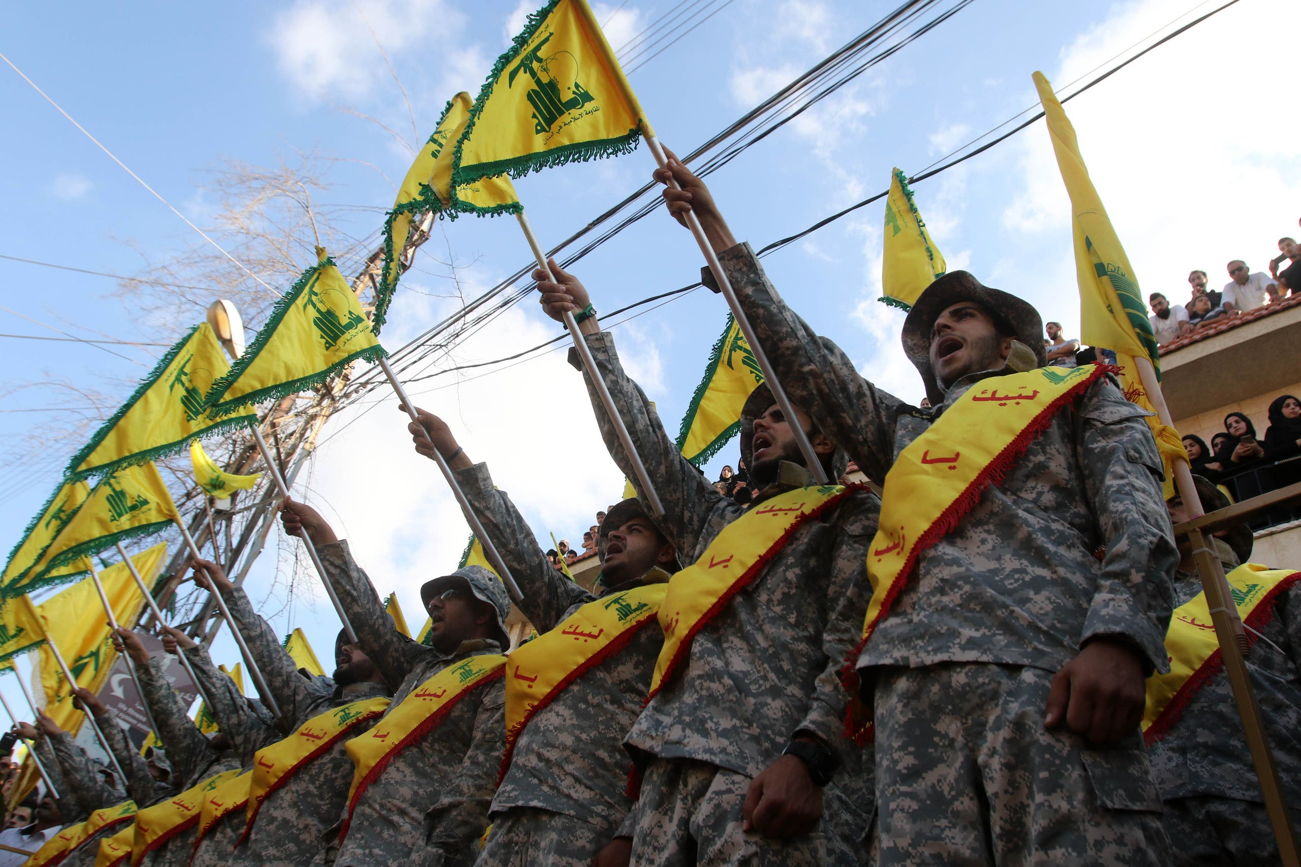 Members of Lebanon's Shiite Hezbollah movement stand at attention during the funeral of a fighter, who was killed in conflict against militant groups in the mountainous area around the Lebanese town of Arsal on the eastern border with war-ravaged Syria, in the southern town of Bisariyeh on August 28, 2017. (File photo: Reuters)