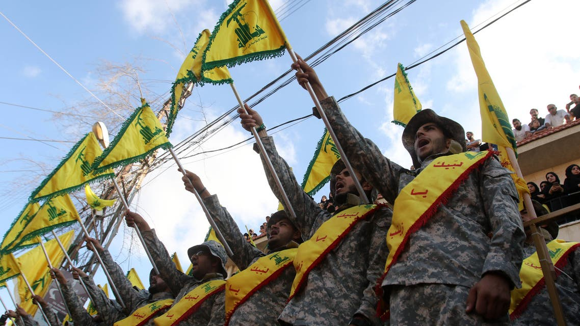 Members of Lebanon's Shiite Hezbollah movement stand at attention during the funeral of a fighter, who was killed in conflict against militant groups in the mountainous area around the Lebanese town of Arsal on the eastern border with war-ravaged Syria, in the southern town of Bisariyeh on August 28, 2017.