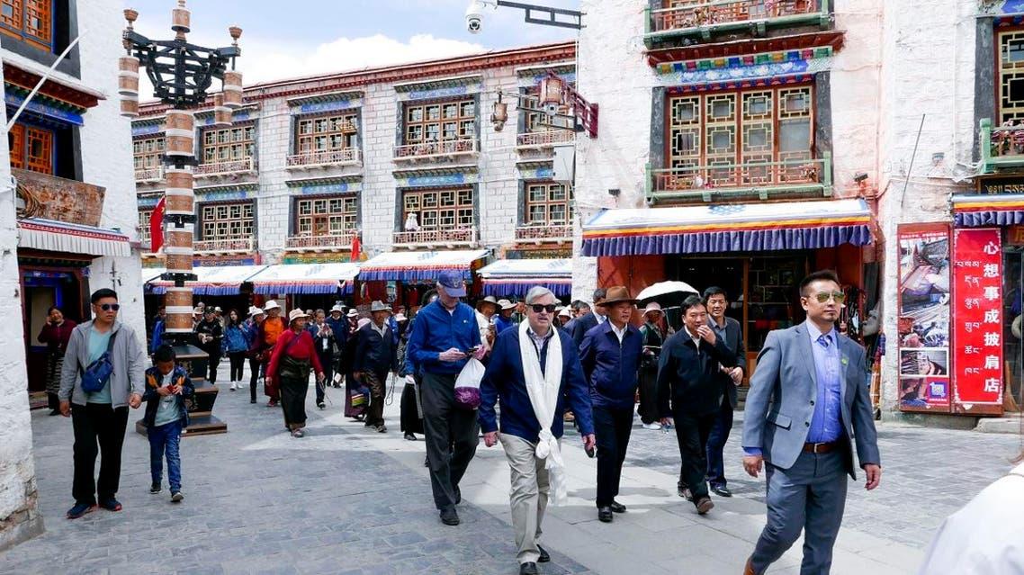 US Ambassador to China Terry Branstad (center), walks along a street in Lhasa in western China's Tibet Autonomous Region. (AP)