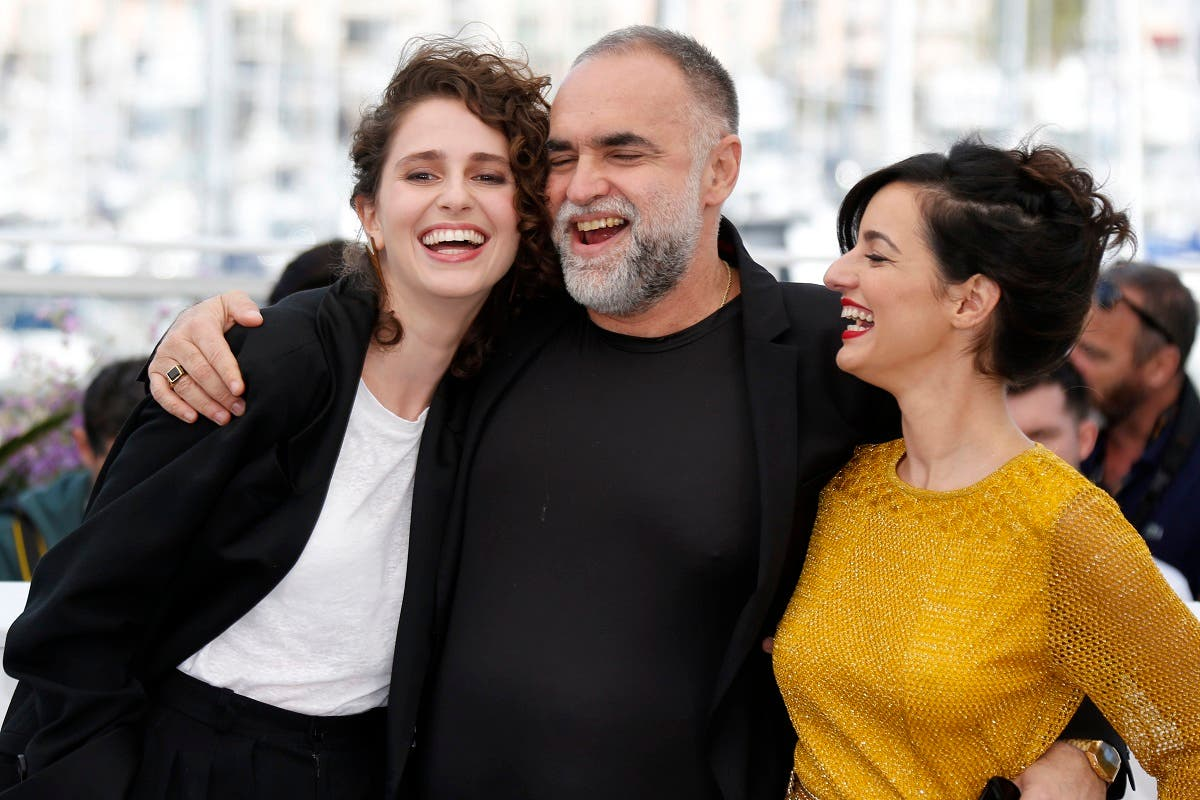 "Director Karim Ainouz and cast members Carol Duarte and Julia Stockler pose during the photocall for the film ""The Invisible Life of Euridice Gusmao"". (Reuters)"