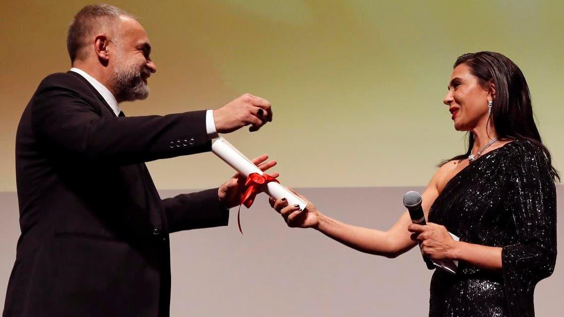 "Jury President of Film selection ""Un Certain Regard"" Nadine Labaki hands winner director Karim Ainouz the Grand Prix Un Certain Regard Award for the film ""The Invisible Life of Euridice Gusmao."" (Reuters)"