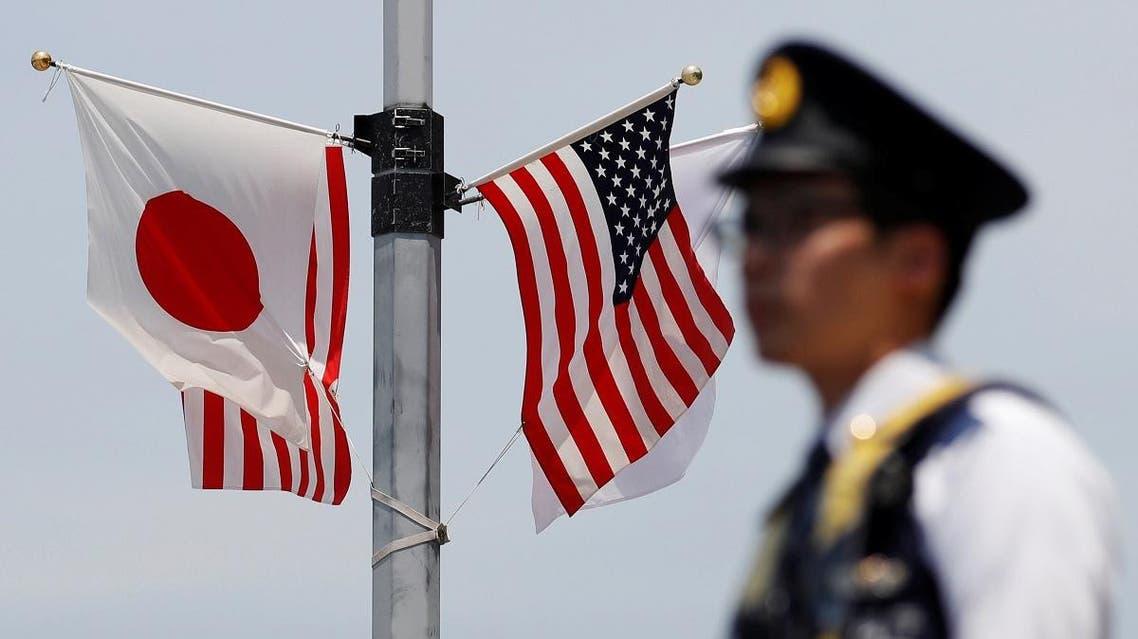 US Japan flags. (Reuters)