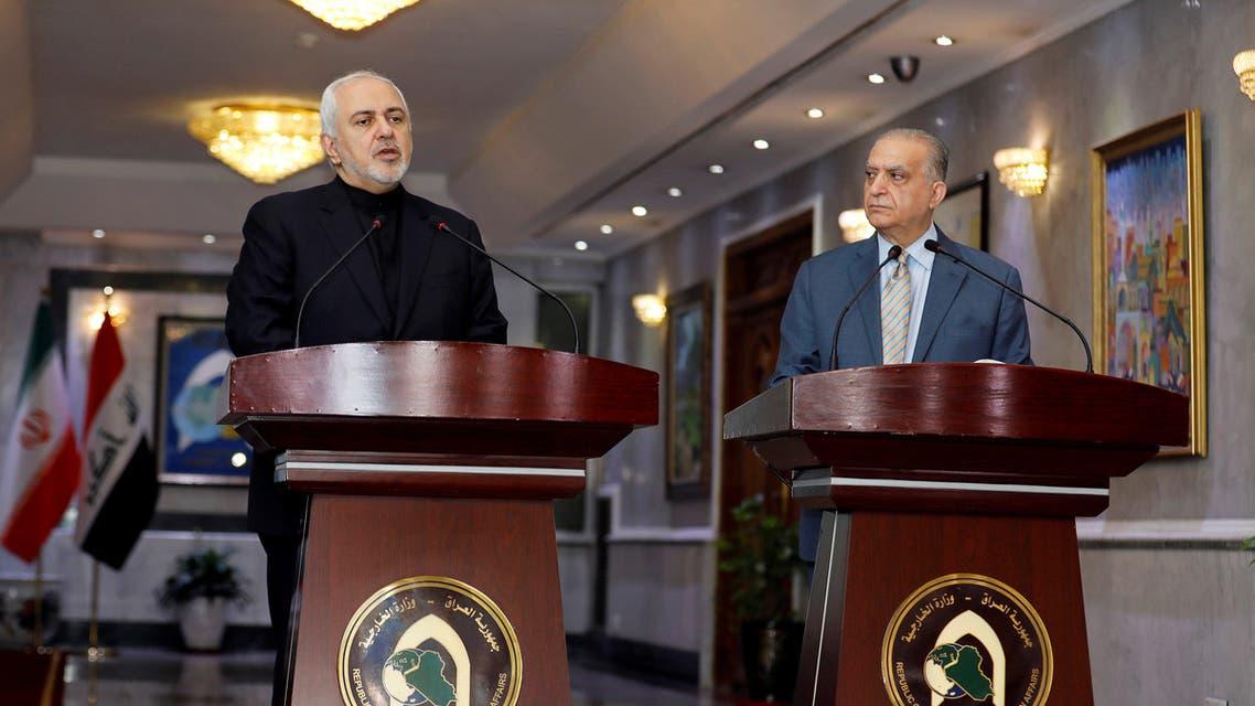 ظريف ونظيره العراقي محمد علي الحكيم(رويترز)