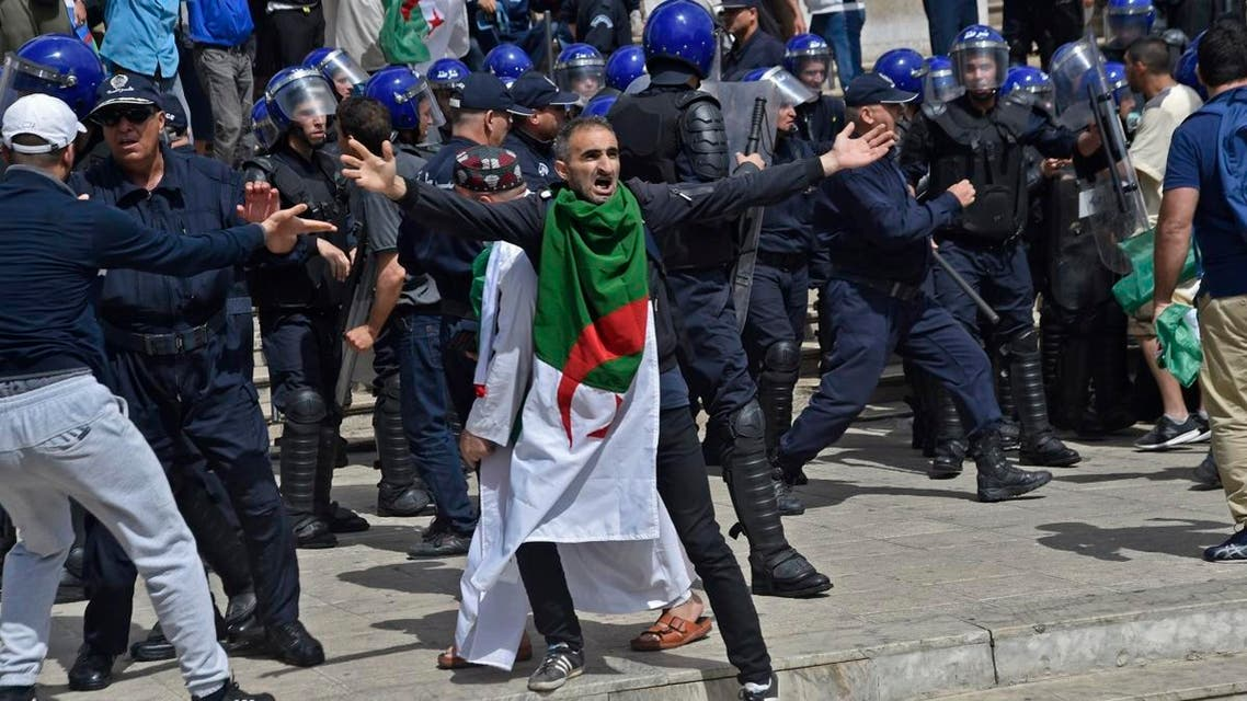 An Algerian protester reacts during an anti-government demonstration outside La Grande Poste (main post office) in the centre of the capital Algiers. (AFP)