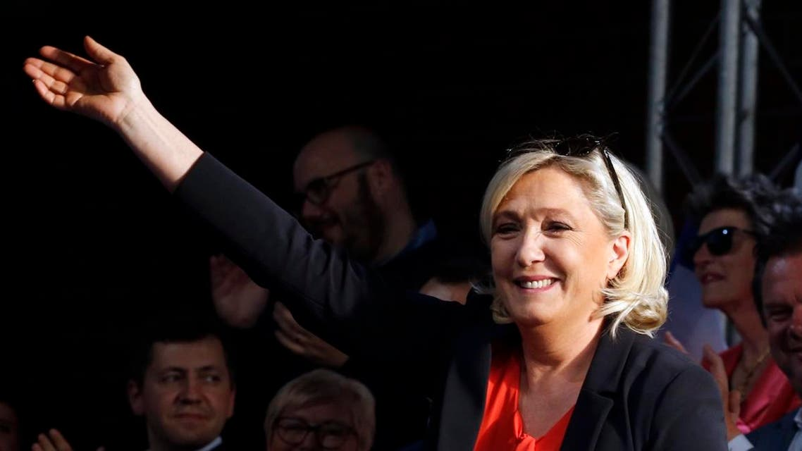National Rally (Rassemblement National) party leader Marine Le Pen waves at a rally in Henin-Beaumont, France. (Reuters)